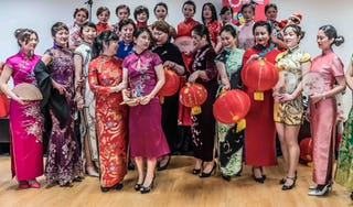 Women dressed in the traditional Qipao dress